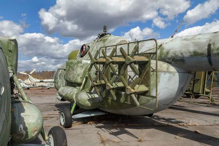 airstrip: Old broken russian heavy transport helicopter an abandoned aerodrome