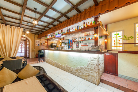 MOSCOW - AUGUST 2014: Interior of network inexpensive restaurant of Italian cuisine - DA PINO. A bar counter with alcohol