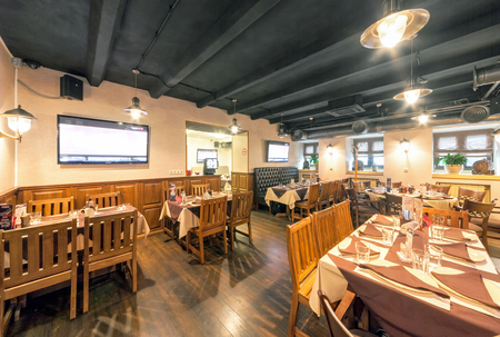 MOSCOW - AUGUST 2014: The interior of the beer bar SHTIRBEERLITZ. Bar hall with wooden furniture