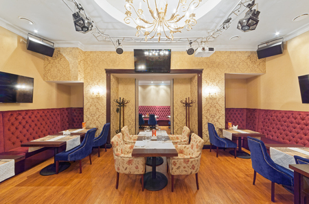 MOSCOW - SEPTEMBER 2014: The interior of the cafe grill bar NA MEDOVOY. A small room with tables and a corner sofa