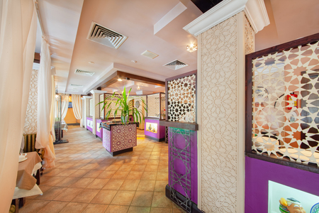 MOSCOW - SEPTEMBER 2014: The interior of the oriental restaurant SANDYK. Chaikhana of Uzbek cuisine. Decorative screens with oriental patterns.