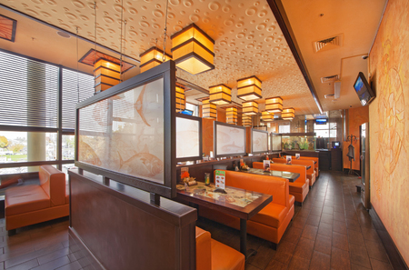 MOSCOW - SEPTEMBER 2014: The interior of the popular Japanese sushi restaurant TANUKI. Hall with leather orange sofas
