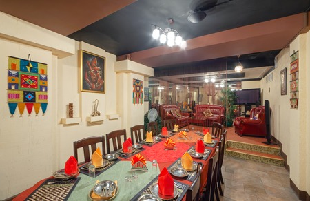 MOSCOW - SEPTEMBER 2014: Interior and furnishings of the restaurant of Indian cuisine KHAJURAHO. Long served table in the banquet hall