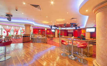 MOSCOW - SEPTEMBER 2014: Interior in modern style of the bar-restaurant FUSION PLAZA of Indian and European cuisine in red and beige color