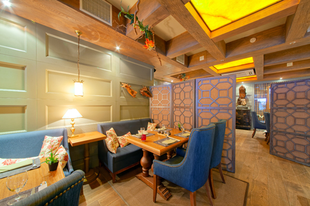 MOSCOW - SEPTEMBER 2014: The interior of a respectable restaurant of Pan-Asian cuisine - FUJIKO. The restaurant is decorated in a colonial style Publikacyjne