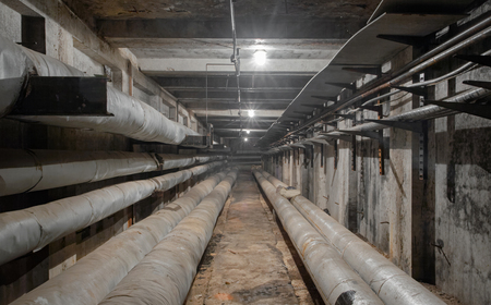 Underground concrete utility tunnel network of water supply pipeline, heat pipeline and cable vault