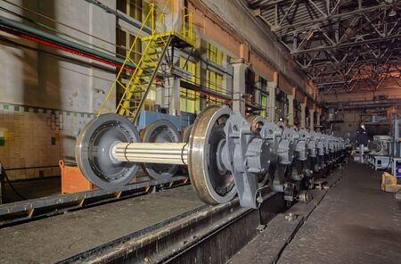 Many spare railway metro wheels on the rail inside plant