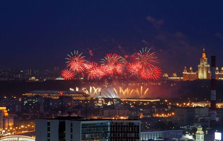Fireworks over the city center at night. Moscow, Russia view from a height