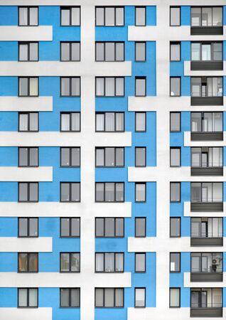The facade of a blue modern high-rise building. Windows and balconies. Zdjęcie Seryjne - 136678473