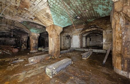 Interior of an abandoned underground wine warehouse of the 19th century Zdjęcie Seryjne - 136678530