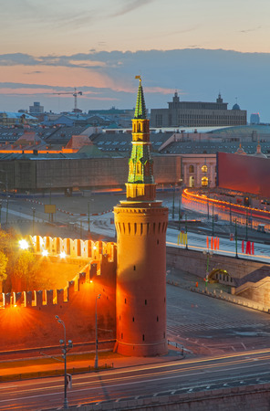 View of the Moscow Kremlin and the Kremlin Embankment at dawn. Tower of the Kremlin - Beklemishevskaya Tower or Moskvoretskaya Tower