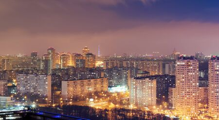 Night cityscape with lots of high rise buildings in residential area