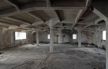 The interior of an empty industrial room of an old abandoned brewing plant