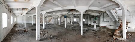 Panorama of the interior of the factory premises on an old abandoned brewery