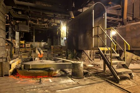 Closed lid of a vertical cast iron melting furnace in a foundry
