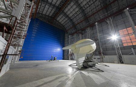 Aerostat on a mobile mooring platform inside an giant airship hangar huge blue gates Zdjęcie Seryjne