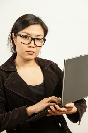 Attractive Asian working business woman shooting in isolated background photo