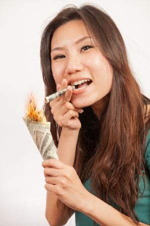rich success woman show burning money to show off photo
