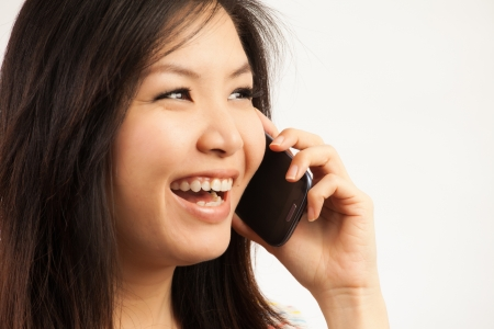 Young Asian woman talking to the phone Stock Photo - 19250107