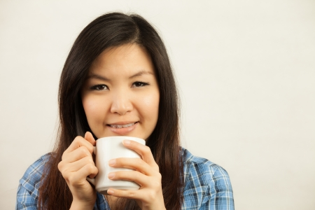 coffee hour: Asian woman with hot drink Stock Photo