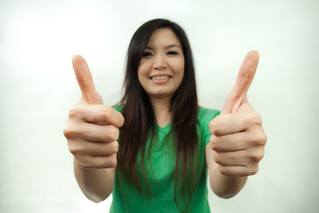 Asian woman in green set, thumbs up photo
