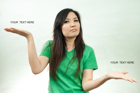 unethical: Asian woman in green set, weight good and bad Stock Photo