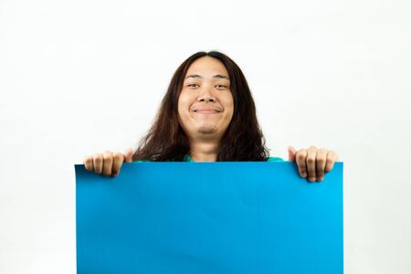 asian man in blue, with a blank card that can be replace photo