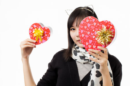 asian woman valentines day giving and receiving gift photo