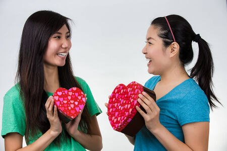 asian woman valentines day giving and receiving gift
