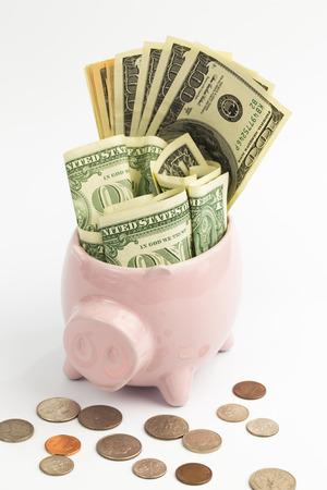 saving money in the piggy bank photo