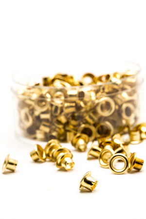 brass eyelet shooting in white background