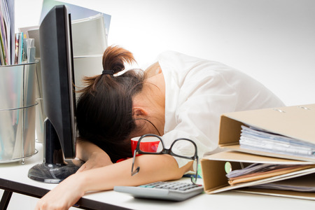 overworked: asian working woman on white background