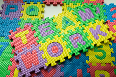 alphabet puzzle colorful shooting in white backtground photo