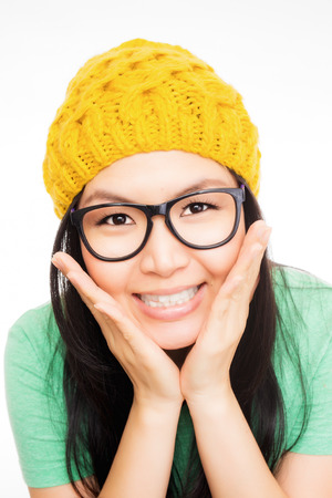 yelllow: attractive smilling asian woman wearing yelllow hat