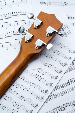 ukulele shooting with music sheets photo