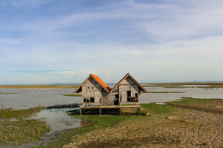 Abandoned house in Thale Noi lake at Phatthalung province,Thailand.