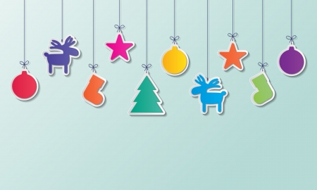 christmas balls, reindeers, socks, christmas tree and stars hanging on green background.
