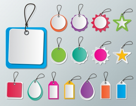 set of blank multi colored paper tags and labels with strings
