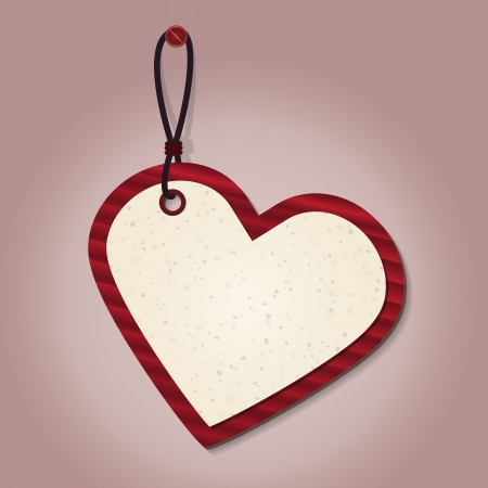 red cardboard heart shape tag hanging on the pink wall.