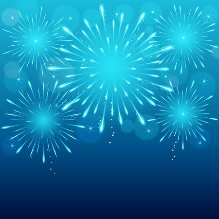 exploding fireworks on blue blurry night sky background.