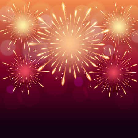 exploding fireworks on red pink blurry night sky background.