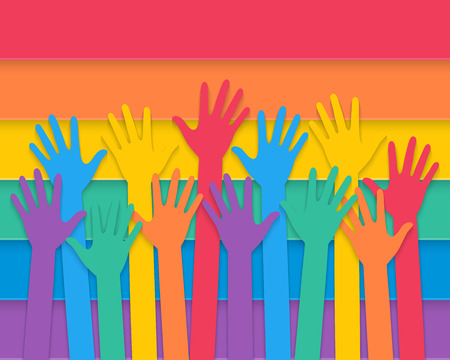 colorful hands raising up with rainbow colors of pride flag