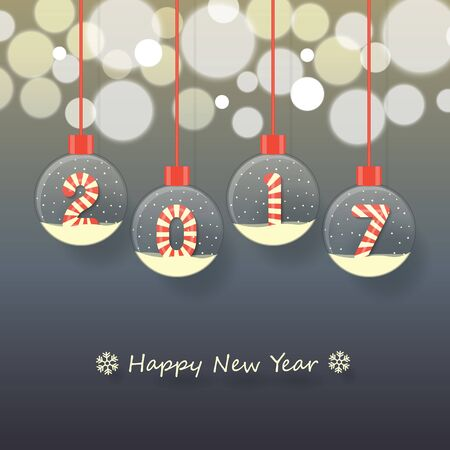 year 2017 sign in red and white Christmas sweet style in snow globe hanging on glowing blurry dark background.