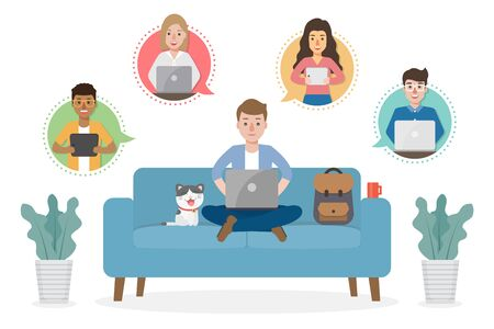A man working from home during Covid-19 pandemic by sitting with a cat on sofa at living room doing teleconference with colleagues. Work from home concept.