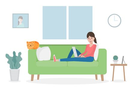 A woman working from home during Covid-19 pandemic by sitting with a cat on sofa at living room using computer laptop. Work from home concept.