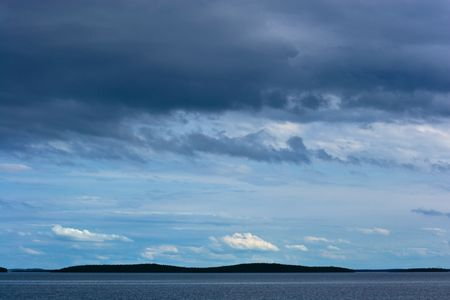 Silhouette of far away islands under stormy sky Stock Photo - 2904820