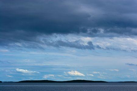 Silhouette of far away islands under stormy sky Stock Photo - 2904820