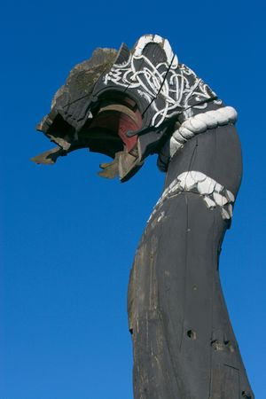 Head of old ship, black with white ornamental pattern    Vyborg, Russia photo