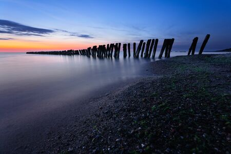 breakwaters: Breakwaters at twilight. Baltic Sea, Russia