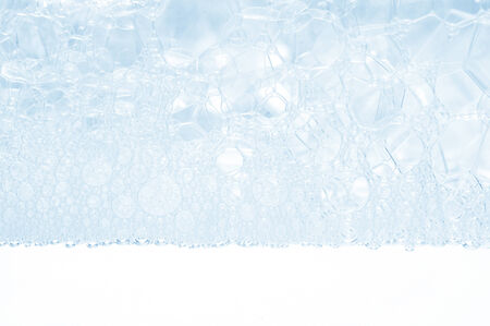 Soap foam and bubbles background photo